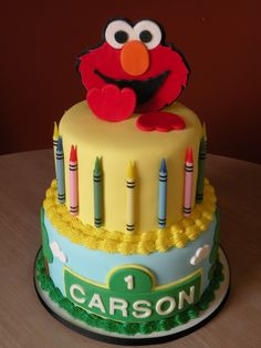Elmo 1st birthday cake - Elmo cake made for a 1st birthday. Client sent a cake picture that they liked that had real crayons stuck on it...but I found crayon shaped birthday candles instead. :)