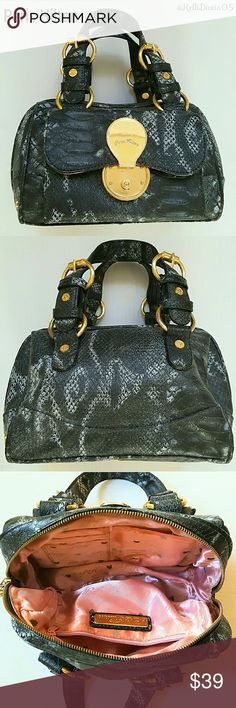 Paris Hilton Python Embossed Black Mini Satchel Pre owned-good condition. Gray and black python embossed mini satchel handbag. Gold tone hardware- slightly tarnished in some areas. Double handles. Center top zip closure. Gold clasp fastened front pocket- convenient for storing phone. Interior is lined in a pink satin-like material with an iconic Paris Hilton pattern. One interior zip pocket, 3 card slots and one open slot pocket. DISCOUNTED BUNDLES AND FREE GIFT WITH EVERY PURCHASE! Paris…