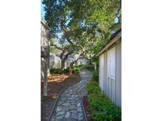CASTRO HOUSE - backyard walkway, playhouse on right