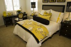 This bedroom features a bright gold-on-white with black color scheme resembling honey bees.