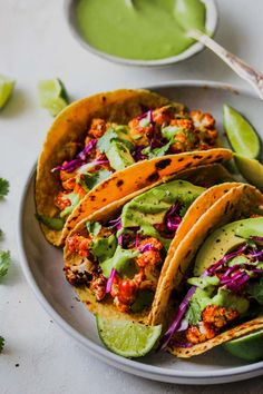 BBQ cauliflower tacos with green tahini sauce are hearty and healthy with bright flavors for a fresh dinner. Vegan, gluten-free, and weeknight-friendly. Vegan Dinner Recipes, Vegan Dinners, Raw Food Recipes, Gourmet Recipes, Mexican Food Recipes, Vegetarian Recipes, Healthy Recipes, Healthy Food, Vegetarian Tacos