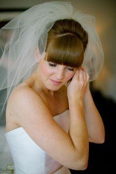 Mod bangs offset a classic bridal veil | Brides.com