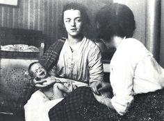 1920s Glasgow A health worker visits a mother and newborn