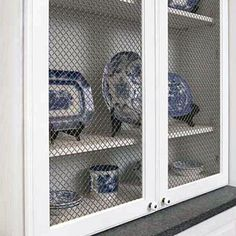 You can create cabinet door inserts using unique materials like louvered panels, hole caning, patterned tin, or wire grating.See more cabinet ideas in our Kitchen Cabinets video. Kitchen Cabinets Glass Inserts, Types Of Kitchen Cabinets, Kitchen Cabinet Doors, Kitchen Cabinet Design, White Cabinets, Cabinet Types, Open Cabinets, Cabinet Fronts, China Cabinet