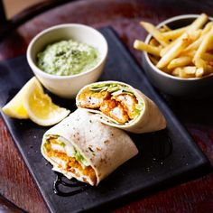 Fish finger wraps made with shredded lettuce and tartare sauce. Serve the wraps with classic french fries and drizzle with balsamic vinegar - a tasty dish that's ready in 20 minutes.