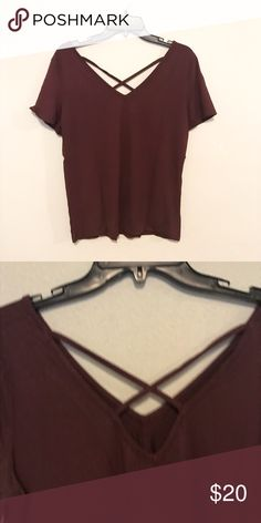 " Burgundy Criss Cross New burgundy top. Soft and light weight. Size L Material: Rayon Approx. Measurements: ▪️Bust: 38"" ▪️Length: 24.5"" Tops"