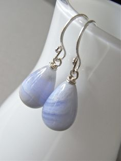 The Faded Denim earrings - smooth blue lace agate teardrops have been finished with bright sterling