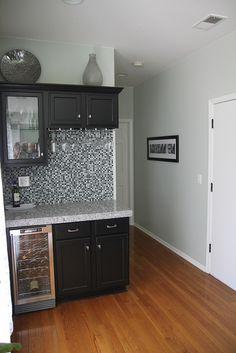 Granite tile countertops, sweet backsplash, black cabinets