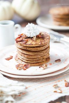 Gluten-Free and Paleo Spiced Pumpkin Pancakes with a bacon pecan topping.
