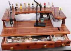 Fly Tying Station is handmade in the USA, with quality Cedar, which will last a lifetime. Nothing captures the essence of the outdoors like rustic cedar. The unique design, combines a large workspace and storage room, with overall dimensions of 27 W x 23 1/2 D x 8 1/2 H, not including the brass thread spindles    Over the past 45 years of tying flys, I have seen most fly tying Benches end up in the closet, for the simple fact that they looked good, but were not functional. In most cases…