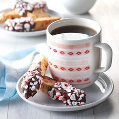 Peppermint Biscotti Recipe -Dipped in melted chocolate and rolled in crushed peppermint candy, this flavorful biscotti is a favorite. It's one of the many sweets I make for Christmas. —Paula Marchesi, Lenhartsville, Pennsylvania