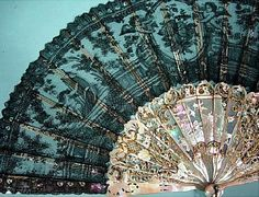 Beautiful Fan, detail, Duvelleroy, Paris, 1870, black Chantilly lace and carved, pierced and gilded mother-of-pearl sticks.