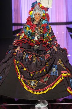 6.Crinoline Hoop Skirt:John Galliano Fall 2004 Ready-to-Wear Collection Slideshow. A Crinoline Hoop Skirt is used to round and extend the shape of the skirt for a half sphere like effect.