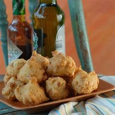 Serve these pan-fried, battered clam cakes with malt vinegar or hot sauce. Use the reserved clam juice and beer in the tasty batter.