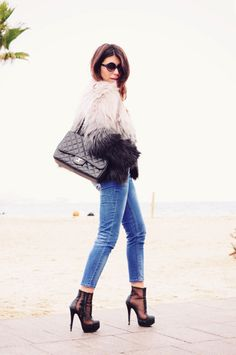 faux fur (this is important!), chanel, shoe boots, sunglasses. simple.