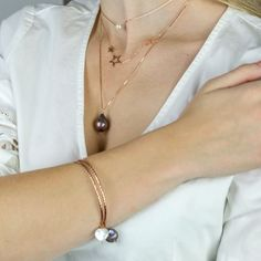 Layered gorgeous pearl and rose gold necklaces and bracelets #layerednecklaces #layeredbracelets #rosegold #boho #dainty #long #choker #pearl #gemstone #bangles