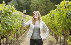 dailymail.co.uk Young woman holding a glass of red wine in a vineyard