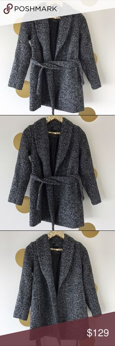 """The Limited Tweed Wool Wrap Jacket Absolutely stunning jacket for any occasion. Worn only a few times - excellent condition! Size XXS Petite. If you're a size 0-2 and under 5'3"""" this jacket was made for you. It's GORGEOUS. Wool blend with polyester lining. Substantial marled tweed Smooth lapels, removable self-tie belt Full sleeves Slash front pockets Fully lined From centerback to hem: Petite=30"""" 58% Polyester/14% Cotton/14% Acrylic/11% Wool/3% Other Fibers; Lining: 100% Polyester Dry…"""