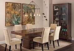 Rustic Modern: A rustic wooden table with a sleek modern finish sets the scene in this elegant dining room. Tahoe Dining Table, $1,299. Sherwin Williams Worldly Gray