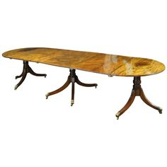 George III Regency Triple Pedestal Dining Table | From a unique collection of antique and modern dining room tables at http://www.1stdibs.com/furniture/tables/dining-room-tables/