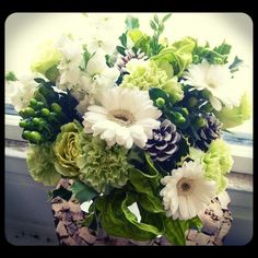 Winter white and green centerpiece.  Roberts Flowers of Hanover, Hanover, NH