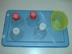 unscrew cap put it in container.  GREAT task for learners who need to strengthen fine motor muscles! *remember, LEFT to RIGHT structured set up!