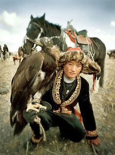 Samarkand, 13 years old, the youngest eagle hunter competitor -. Asia; Mongolia