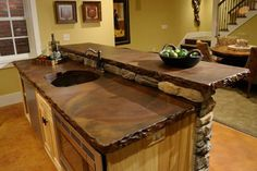 Concrete countertops & rock surround OR USE BRICK EDGE?? LOVE LIVE EDGE AND LOOK OF FAUX WOOD OR ZINC IN CONCRETE