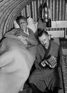 Oct. 19, 1940    Mr. and Mrs. Murray bed down for the night in their Anderson shelter.