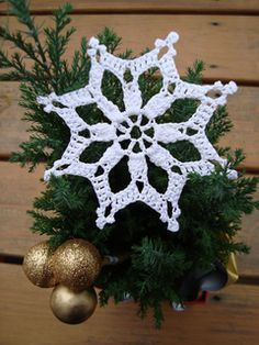 Free pattern by Maggie Weldon for a snowflake ornament.