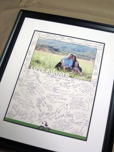 use a large poster with an engagement photo in the middle and allow plenty of room for guests to write something. Frame and hang in your home.