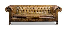 AN ENGLISH BROWN BUTTONED-LEATHER CHESTERFIELD THREE-SEAT SOFA LATE 20TH CENTURY