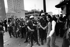 Folk singer Joan Baez is arrested by police and directed to a nearby police wagon during the sit-in demonstration in front of the Oakland Induction Center in Oakland, Calif., on Oct. 16, 1967. Demonstrators blocked the building entrance in protest of the Vietnam war draft. (AP Photo)