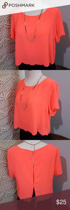 """Lush Neon Coral Scalloped Crepe Crop Top S Excellent condition scalloped crop top by Lush. Size Small but can also fit a medium. Bright neon coral pink color is so perfect for summer! Loose, boxy relaxed fit. Short sleeves. Scalloped raw cut edges. Crepe polyester has stretch. Back peek-a-boo slits with single button closure. Loos cute with a matching bralette peeking through! Bust 40"""", length 17.5"""", 40"""" around hemline. Lush Tops Crop Tops"""