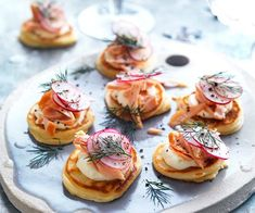 Entertaining is simple with these quick spelt blini topped with hot-smoked salmon and crème fraîche