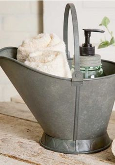 Galvanized metal coal scuttle found in every coal miner's home. Love this idea for a bathroom.