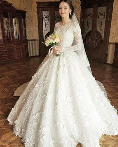 A beautiful wedding gown with floral appliques. A beautiful wedding gown with floral appliques. Muslim Wedding Dresses, V Neck Wedding Dress, Country Wedding Dresses, Modest Wedding Dresses, Boho Wedding Dress, Bridal Dresses, Gown Wedding, Dresses Dresses, Beautiful Wedding Gowns