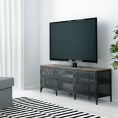 FJÄLLBO TV unit, black, This rustic metal and solid wood TV bench has an open back, so it's easy to arrange cords and cables. Metal Tv Stand, Black Tv Stand, Industrial Tv Stand, Design Industrial, Fjällbo Ikea, Tv Banco, Black Tv Unit, Ikea Tv Unit, Ikea Tv Stand