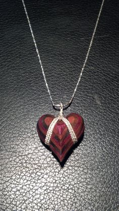 A veneered heart necklace made from from 5 different types of exotic wood for my lovely girlfriend.