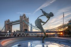 """""""Girl with a Dolphin"""" statue, on the North bank of the Thames near Tower Bridge."""