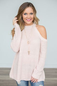 """Cold shoulder sweater in blush. Cotton/Acrylic. Hand wash cold.Model is wearing a size small. Fits true to size. Measurements from shoulder to hem 29"""""""" (S,M,L).S (2-4) M (6-8) L (10-12). Style #T120"""