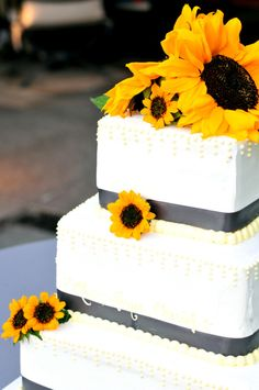 sunflower wedding cake with flower only on top maybe