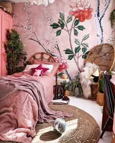 This bold and bright home features interesting wall paint colors (from navy blue to pink) and wallpaper ideas throughout the house. Each room has a different theme, but with gallery walls, rattan furniture  and disco ball throughout, they all feel cohesive.