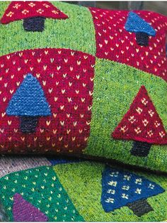 Nordic Cushion - Knit this stunning homeware throw from Easy Fairisle Knits. Designed by Martin Storey using the gorgeous yarn Felted Tweed DK (wool), this brightly coloured throw is made up of large squares with the addition of these sweet garter stitch and fairisle nordic trees.