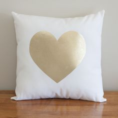 A gorgeous gold foil heart cushion. Made with crisp white canvas & finished with a gold metallic foil heart. This on trend accent cushion looks great in a nursery, on a couch or as a finishing touch on your bed. Pair it with any of our other gold cushions