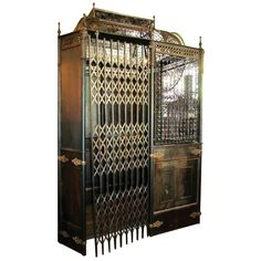 Antique Otis Birdcage Elevator with Original Hardware, Finials and Scissor Doors | From a unique collection of antique and modern architectural elements at https://www.1stdibs.com/furniture/building-garden/architectural-elements/