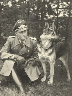 Major Gustav Geiler with his German Shepard named Aga, 1940.