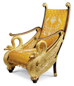 A RUSSIAN PARCEL-GILT AND WALNUT ARMCHAIR Upholstered in patterned yellow silk damask, with scrolled arms supported by swans