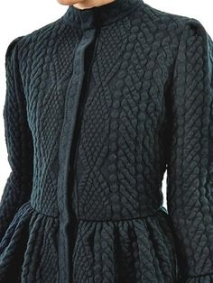 Alexander McQueen. I know this is knitted, but it could be adapted to crochet. Love the peplum on a cardigan.
