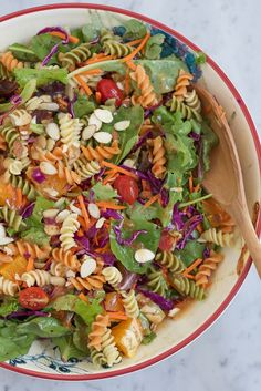 Power Pasta Salad. A must make for summer! Loaded with fresh greens, tomatoes, oranges, carrots, shredded red cabbage, pasta salad and more! My kids love this pasta salad!
